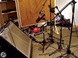 In this picture, you can see how the five close mics were arranged for the overdubbing session. Closest to the amp were aBlue Kickball and aShure SM57; aShure SM7B and an Electrovoice RE20 were set up alittle further back; and an AKG C414B XLS was bringing up the rear.