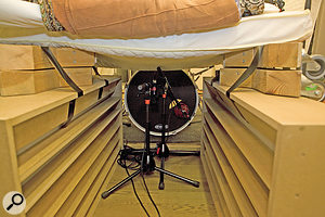 By building an impromptu 'isolation tunnel' over the kick–drum microphones, we were able to shield them from the worst of the upper–spectrum spill from the cymbals and electric guitars.