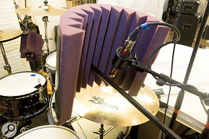 An improvised baffle made from half a  plastic bucket lined with acoustic foam helped reduce hi–hat spill into the ride–cymbal mic, but at the expense of introducing nasty comb–filtering side–effects for the floor–tom mic's cymbals spill.