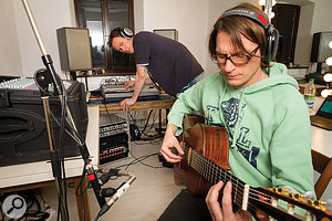 To retain sufficient mixdown control, Mike recorded the majority of Christian's acoustic guitar parts in the control room to avoid spill from the drums, piano and bass in the main room. Both performer and engineer monitored the control–room mix on headphones under those circumstances. Christian maintained sonic consistency between takes by using an old cutlery knife from Mike's toolbag as a  mic positioning template.
