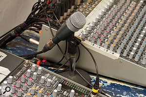 """<span class=""""uk"""">Clockwise from top, t</span><span class=""""us"""">T</span>he three components of Mike's talkback system: a dynamic mic in the control room, a footswitch to activate it, and a loudspeaker on the studio floor to supplement the signal sent to the headphone cue mixes."""