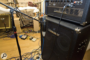 Although the bass-cab mic position gave a  desirable mid-range tone, the room's resonance modes caused problems with the low consistency, so we recorded a  DI signal to work around this.