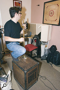 Chris gets busy on the tea-chest bass, which is a surprisingly nice-sounding instrument, in his studio room.