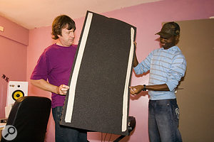 If you're renting, you can avoid upsetting your landlord by sticking adhesive strips to the back of acoustic foam panels and using these to mount them, so that there will be no messy glue marks on the walls.