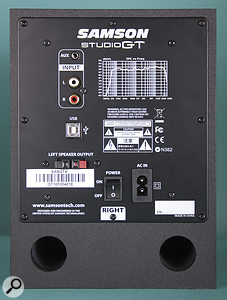 The rear panel of the right speaker, which houses the audio interface. This hosts the auxiliary inputs, the power socket, the USB port and the amplified output to the passive speaker.