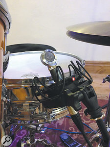 A Shure Beta 181, nestling snugly twixt a  snare drum and a  hi-hat.