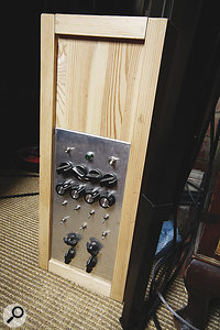 "Tom Jenkinson's custom‑made spring reverb: ""The reverb uses four pairs of Accutronics type 1, 4, 8 and 9 springs. The stereo input stages incorporate a soft-clip circuit, high shelving EQ and spring selectors that send the input to a given pair of springs. There are four output stages to which the springs can be assigned. Each output stage has signal invert, volume and pan controls. The springs can be used in parallel or series, where one spring signal is fed into another. The circuit grounding uses star topology. It was used extensively on the album Hello Everything, in conjunction with my AKG BX15 and BX20 reverbs. It is clearly audible at the starts of 'Bubble Life', 'Circlewave' and 'Plotinus'."""