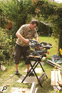 Paul White gets busy with the heavy machinery, as he cuts the timbers to size!
