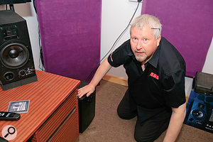 """""""It's not what it looks like!"""" Hugh Robjohns doing nothing at all untoward to Beren Matthews' subwoofer."""