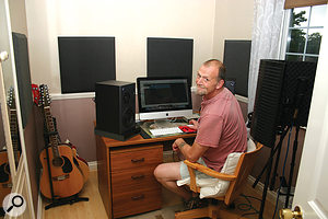 Bill Price in his new studio. Acoustic tiles were put up to tame early reflections from the walls, and some Silent Peaks isolation pads were placed under the speakers to prevent vibrations travelling through the desk. The whole setup was placed off-centre to the right, which resulted in a more even bass response at the listening position.