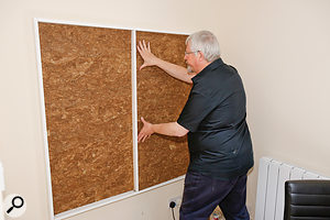 ...into which Hugh Robjohns places the high-density mineral wool, prior to gluing on the acoustic foam.