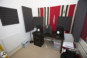 A set of Auralex stand-mounted absorbers could be placed at the listening position when mixing...