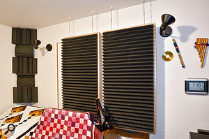 Absorbers were hung from the ceiling, a short distance away from the walls to increase their efficacy at low frequencies.