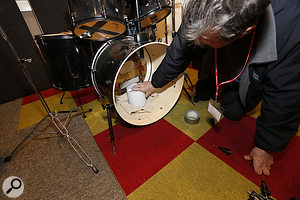 Loosening and tuning the batter head, and adding damping to the kick drum, yielded a much better sound.