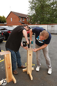 Paul and Nic modifying one of the two wooden speaker stands.