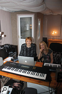 Duke and Sherrie Ashton, in their studio building, with the completed vocal booth in the corner behind them.