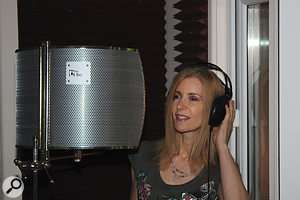 Sherrie, in the vocal booth, with an SE Reflexion Filter helping to further improve the recordings.