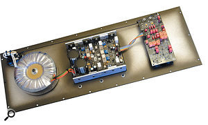 Removing the metal panel on the rear of the speaker reveals the input circuitry, crossovers, amplifiers and power supply.