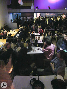The bar area at Nottingham's Broadway Cinema during Swimming's binaural gig. The tiny points of green light visible are LEDs from the audience's wireless headphones.