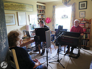 Shirley and Ian with portable harmonium — before it was covered with blankets.