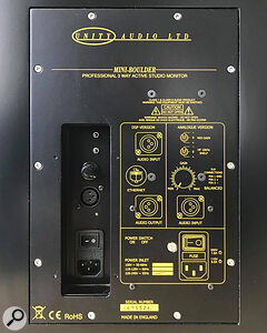 The rear panel houses the XLR input, stepped gain control, and switches for the high and mid EQ options.