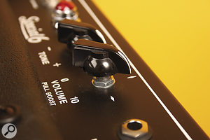 Pulling the volume control out both boosts the signal and changes the voicing of the preamp stage.