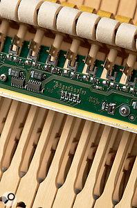 Close‑up of Bösendorfer's patent CEUS piano recording mechanism.