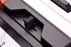 The pitch‑bend lever is recessed at the left‑hand side of the keyboard.
