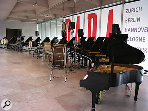 A closer view of the orchestra, with its 16 Gulbransen grand pianos equipped with QRS Pianomation.