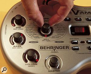 Behringer Bass V-Amp with finger on controls.