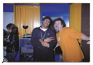 Jean Marie Horvat surprises Mario Winans in the Cabana room for a quick photo op.