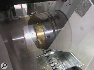 The central pressing chamber of a pressing machine, where molten polycarbonate is shaped using the nickel stamper.