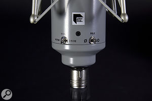 The microphone also features switches for engaging the Drive circuitry, inverting the output polarity, selecting between cardioid and omnidirectional polar patterns, and engaging the 10dB pad.