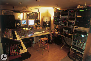 Tony Colman's studio. The live area is behind the DDA desk; equipment racks are to the right, while Roland Juno 106 and Access Virus kb synths are visible to the left.