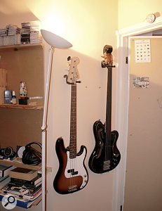 Eno's studio is still home to a few traditional instruments, like these basses.
