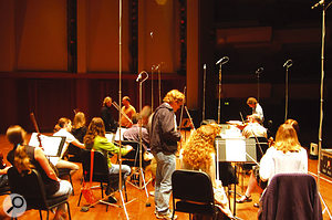 Recording the string ensembles. Doug Rogers of East West and Nick Phoenix of Quantum Leap (in a black suit and a stripy top respectively) are visible at the back of the picture.
