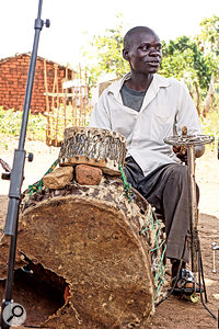 Mulligo, instrument maker for the Malawi Mouse Boys, behind one of his unique creations.