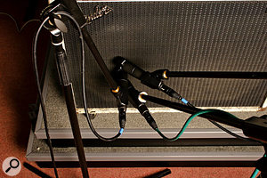 The angle of the mic in relation to the speaker cone will also affect the tone.