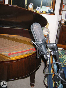 Because of the dimensions of the room, no conventional mic position could be found which offered an uncoloured sound. Therefore, after some experimentation, the final mic position ended up being at the foot of the piano, as shown from two angles here.