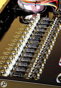 A row of THAT 2180A VCAs, each controlled by its own dedicated D–A, which allow for automated channel gain and recall.