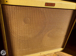 When miking a cab or combo with agrille cloth you can't easily see through, do make sure that you know where the speakers are positioned in the cabinet! For example, it's only with bright light shining on this Fender Blues Deville that you can see where