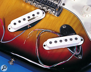 'Noiseless' single-coil pickups, such as these models from Kinman and Dimarzio, will cancel hum effectively, but noise can still get into the system via the wiring and controls.