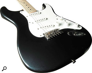 Fender's Eric Clapton Signature Strat may look like a normal strat, but active circuitry inside allows a much stronger mid-boost than on passive designs.