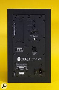 The rear panel houses the inputs, EQ controls, and a  blank slot into which can be installed a  variety of digital input options.