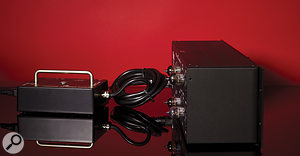 The external power supply attaches to the rack unit via a  sturdy locking connector.