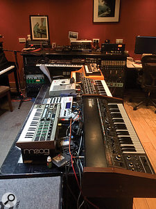 Anthony Khan's main instrument of choice is the Akai MPC sequencer/sampler (rear left).