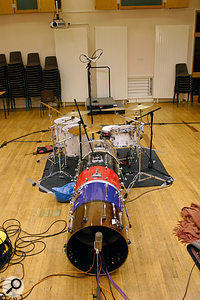For the 'KickDistanceTunnel' audio files, we set up a technique described by the producer Butch Vig, where the kick-drum mics are protected from spill using a six-foot-long tunnel constructed from kick-drum shells. The mics inside the tunnel are the same as those used for the other 'KickDistance' files, but are also joined by an AKG D12 three feet from the drum, and a Neumann U47 FET at the end of the tunnel. For the recordings, we also covered the whole assembly with blankets to damp the drum shells and further reduce spill.