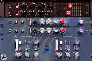 Discrete classics: pairs of Quad Eight channel strips and Brent Averill 1073s perch above two Neve 2254 compressors.