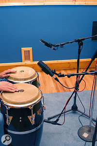 A typical mic setup for the conga, with condensers on top in stereo and a dynamic on the bottom.