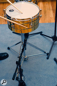 Chapeo is the act -- and art -- of hitting the metal side of the timbales. The overhead microphones mainly pick this up.